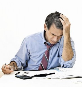 Image of Man stressed lookin through papers worried about Identity theft